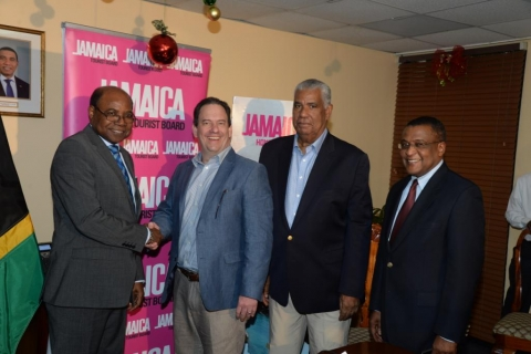 Minister of Tourism, Hon. Edmund Bartlett (left) shakes hands with Airbnb's Public Policy Director for Central America and the Caribbean, Shawn Sullivan following the signing of a memorandum of understanding (MOU) between the Jamaica Tourist Board (JTB) and home-sharing accommodation company Airbnb. Sharing in the moment are Chairman of the JTB, John Lynch (second right); and Director of Tourism, Paul Pennicook.  The agreement, which was signed on December 13, 2016 at the Jamaica Tourist Board's New Kingsto