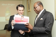 Minister of Tourism, Edmund Bartlett (right), shares Red Stripe's Managing Director Ricardo Nuncio's interest in a brochure on Red Stripe beer, during a courtesy call on the minister at his office in New Kingston on Wednesday.